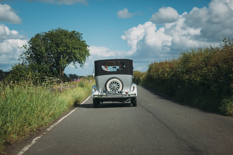 Met Wedding Car - Vintage car on country road