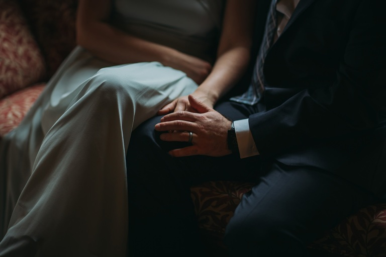 romantic elopement photography Scotland newlyweds hold hands in window light