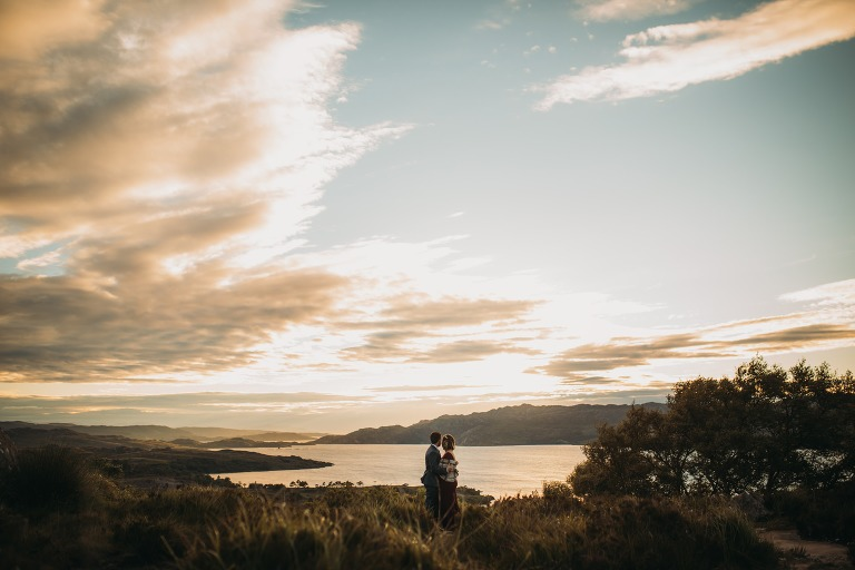 eloping to scotland romantic elopement photography Scotland newlyweds and epic golden view over Torridon
