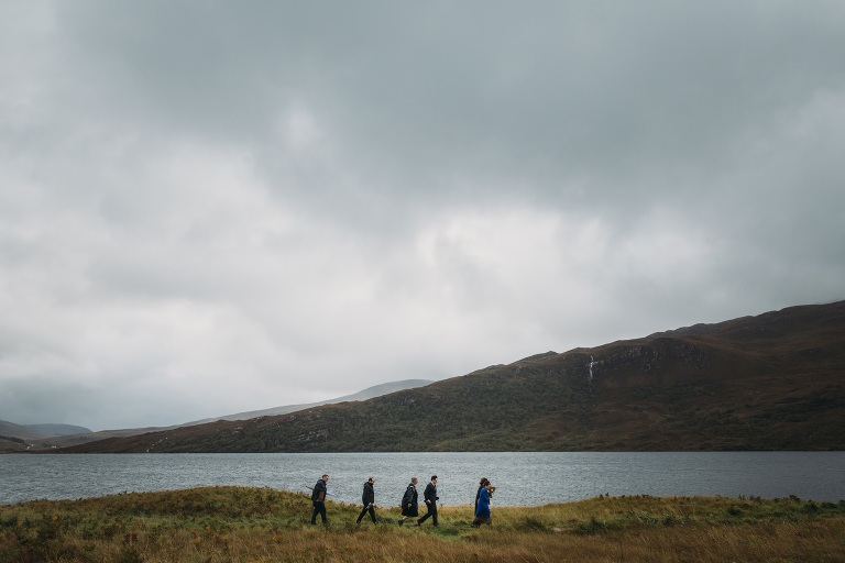 romantic elopement photography Scotland small wedding party walk to ceremony at Ardvreck Castle