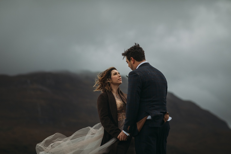 romantic elopement photography Scotland bride gazes lovingly at groom in wild scottish highlands