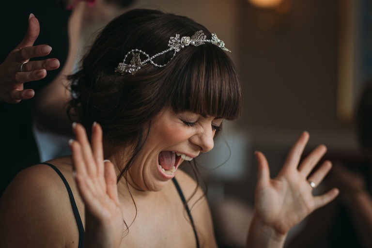 romantic wedding photography Scotland bride excited about her bridal headpiece by Modiste