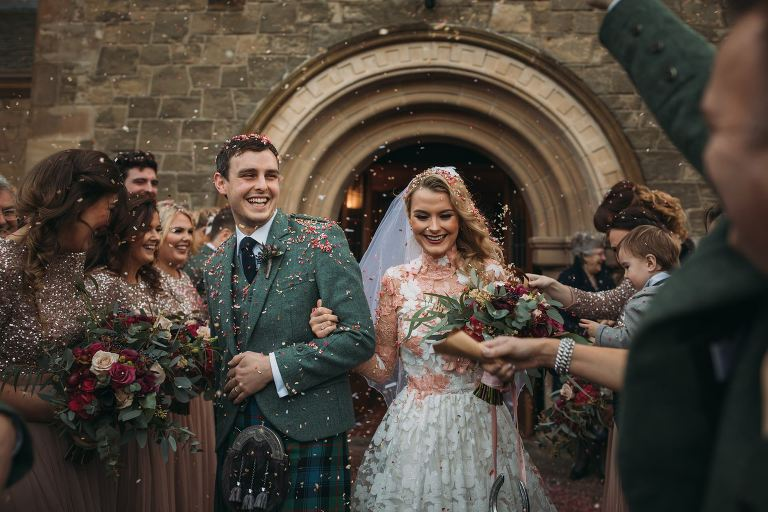 romantic wedding photography Scotland couple covered in confetti in Edinburgh