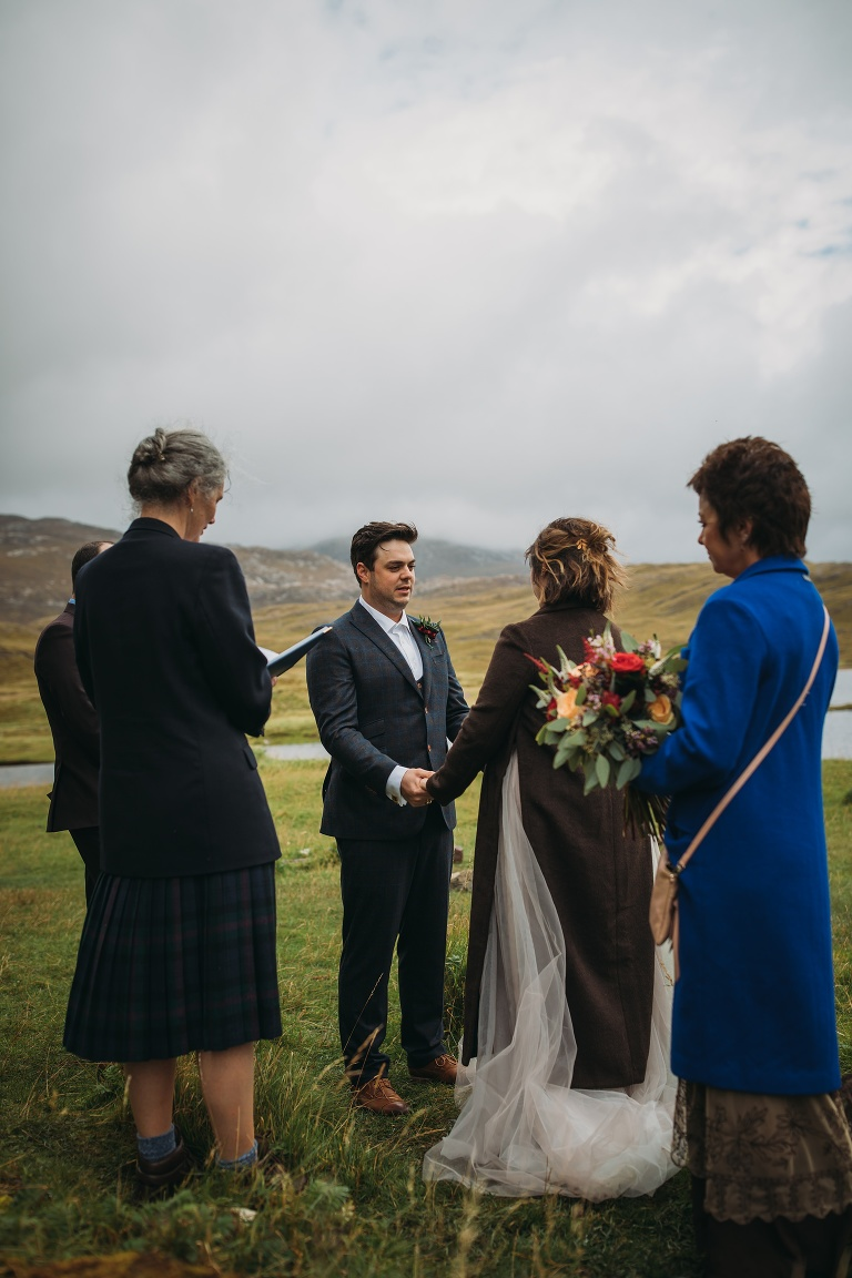 Eloping to Scotland at Lochinver and Ardvreck Castle. Civil ceremony on banks of a loch.