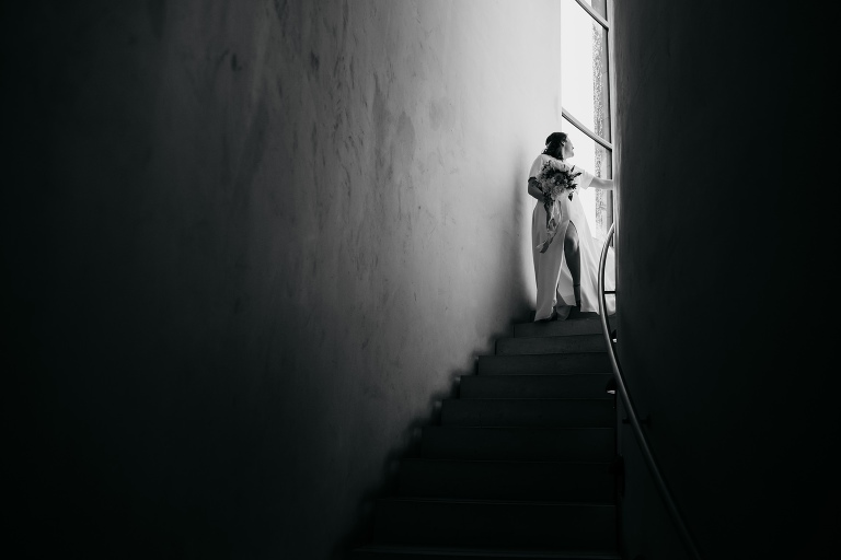 Bride stops at the top of a winding staircase - romantic wedding photography at national museum of scotland